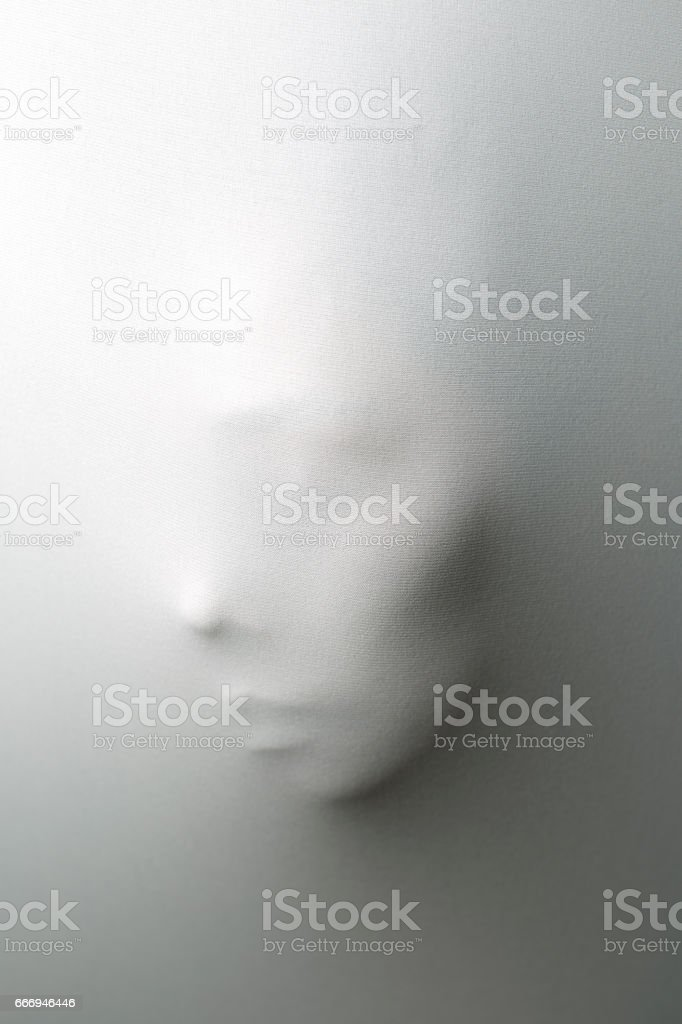 Ghost behind the white curtain stock photo
