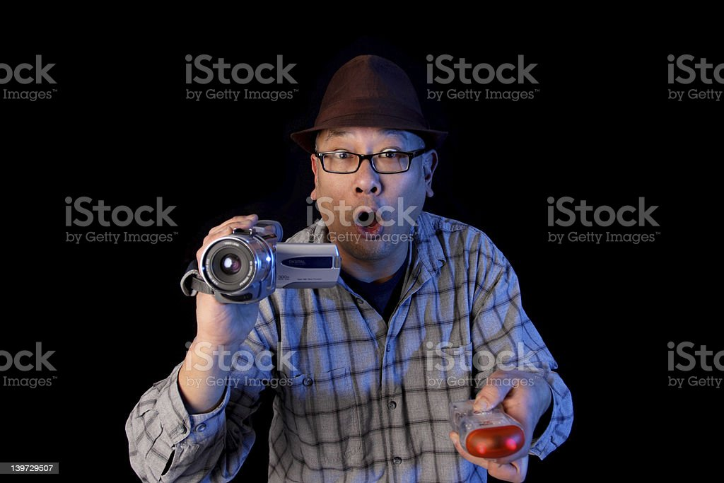 Ghost hunter Ghost hunter with a video camcorder and EMF detector. Adult Stock Photo