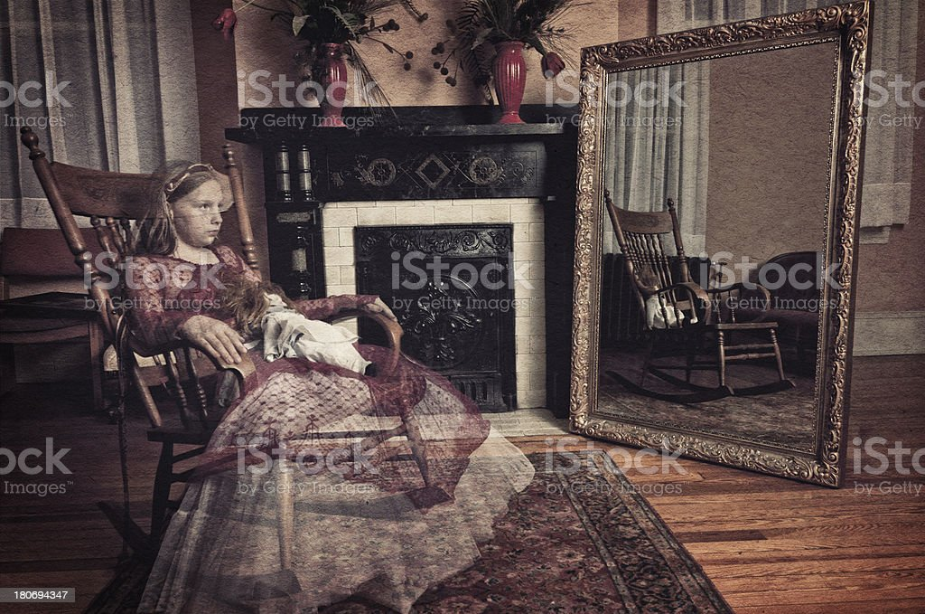 Ghost of little girl sitting in the rocker chair (I) stock photo