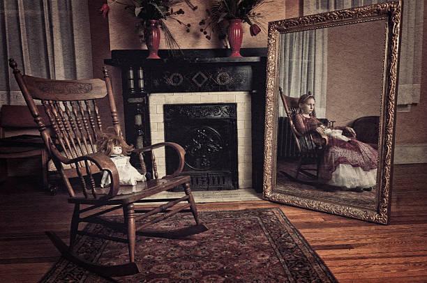 Ghost of little girl sitting in the rocker chair (II) stock photo