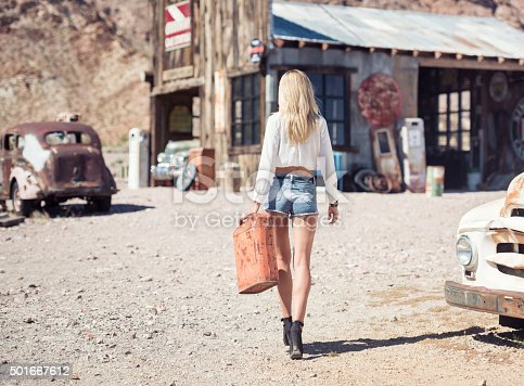 Beautiful model with a stunning body and natural long blond hair getting Gasoline at an abandoned Gasstation in Ghost Town