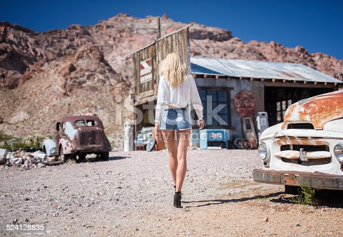 Beautiful model getting Gasoline at an abandoned Gasstation in Ghost Town