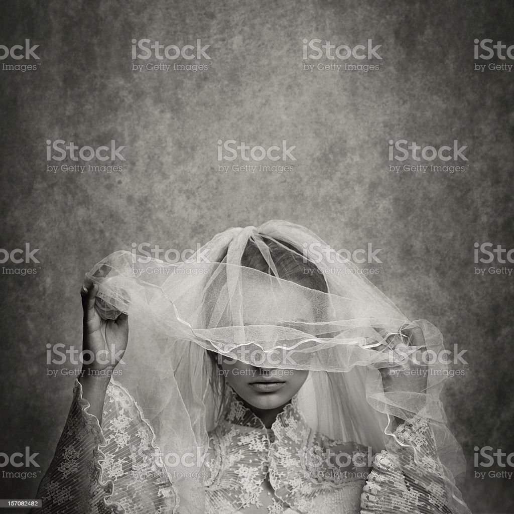ghostly bride raising her veil royalty-free stock photo