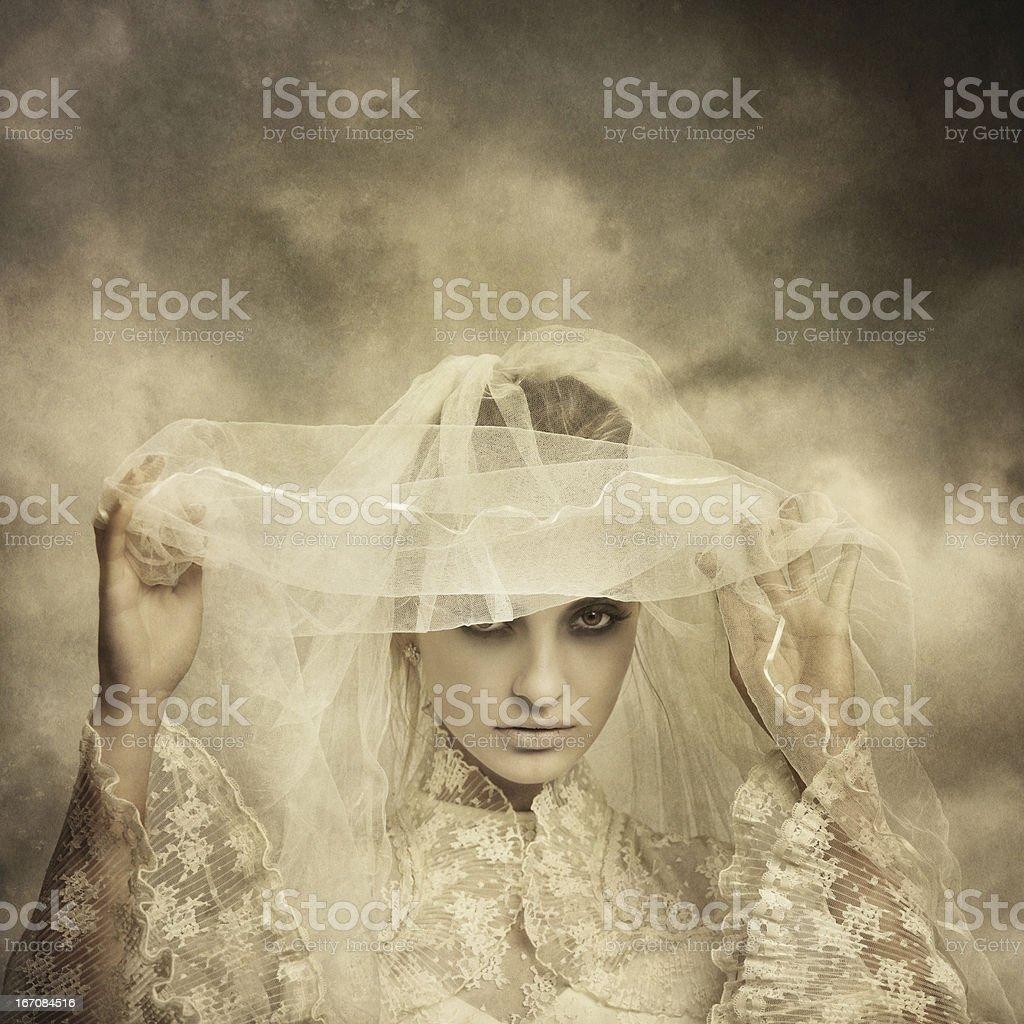 ghostly bride raising her veil stock photo