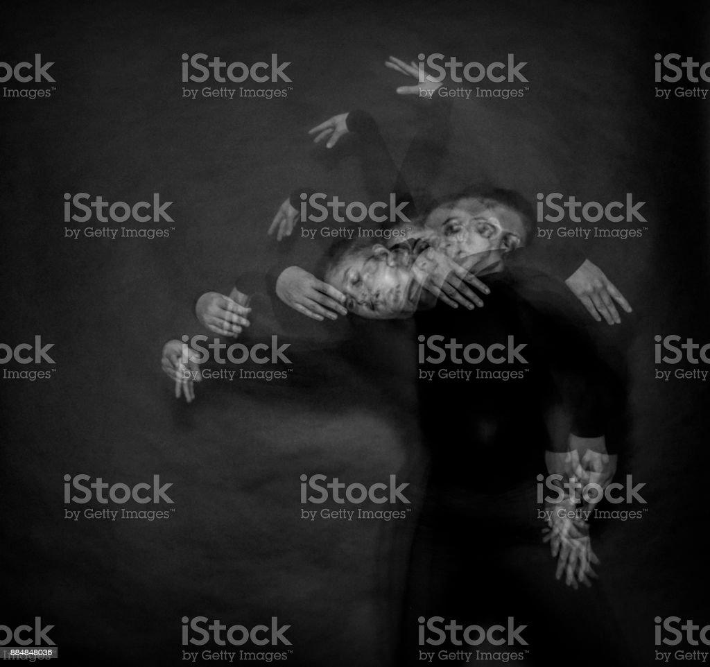 Ghostly figure disembodied hands female stroboscopic flash stock photo