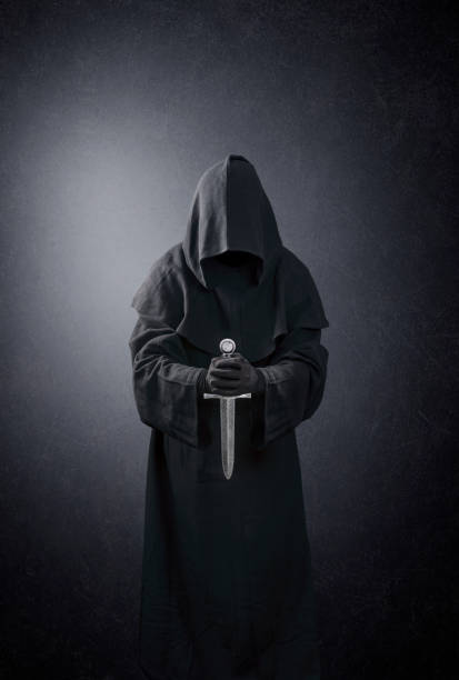 Ghostly figure with medieval dagger in the dark stock photo