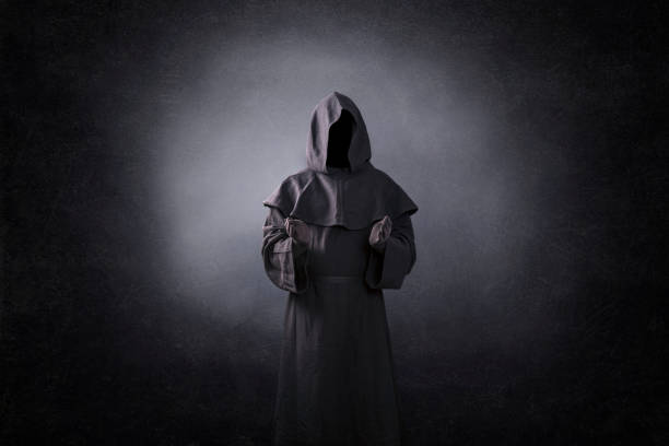 Ghostly figure with open hands in the dark stock photo