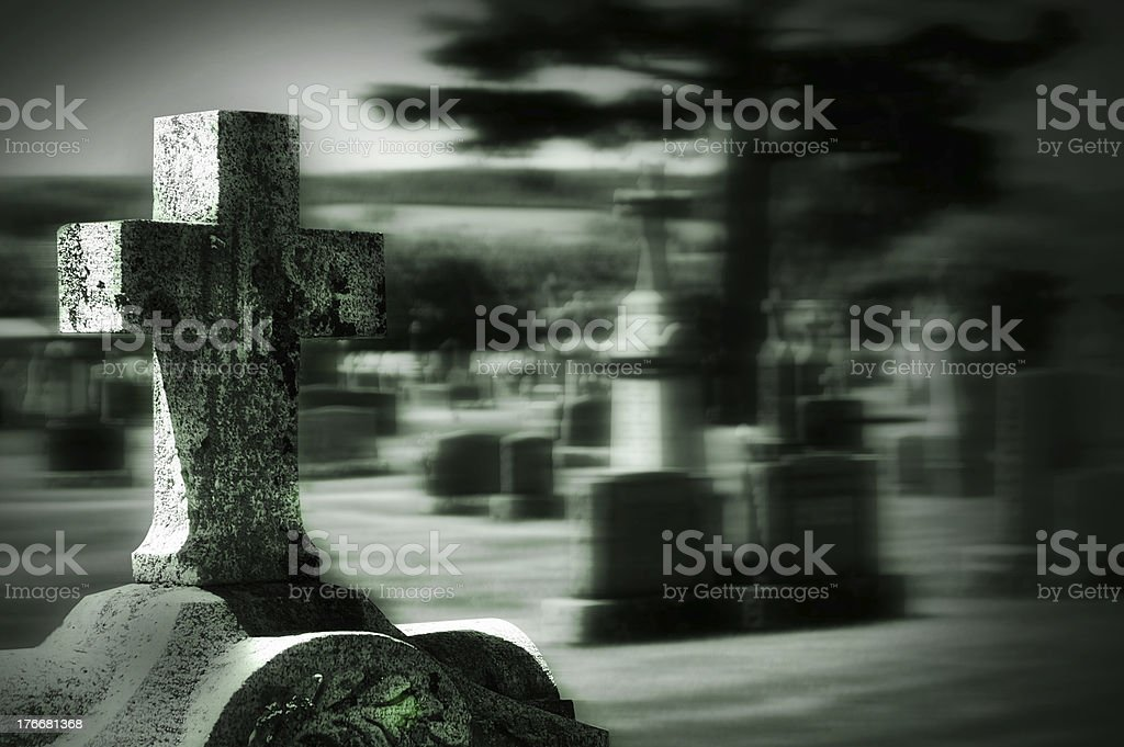Ghostly Tombstone Cross in Cemetery royalty-free stock photo