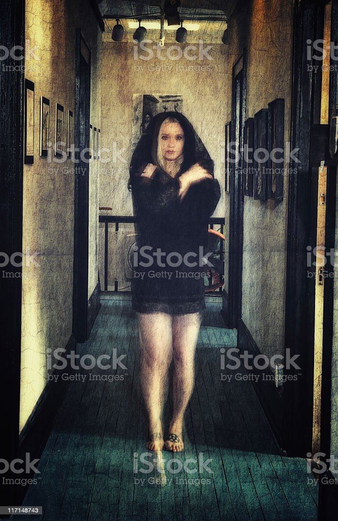 Ghostly Woman Walking the Hall royalty-free stock photo