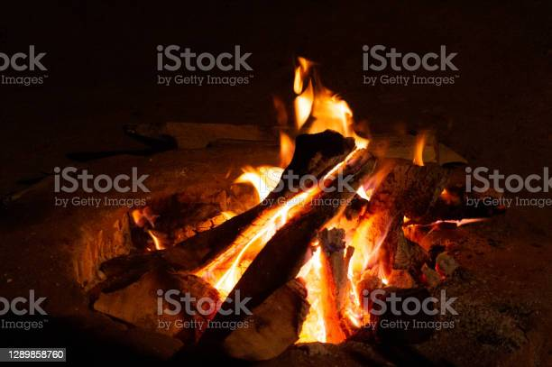 Photo of Giant bon fire lit for the festival of Lohri surrounded by people