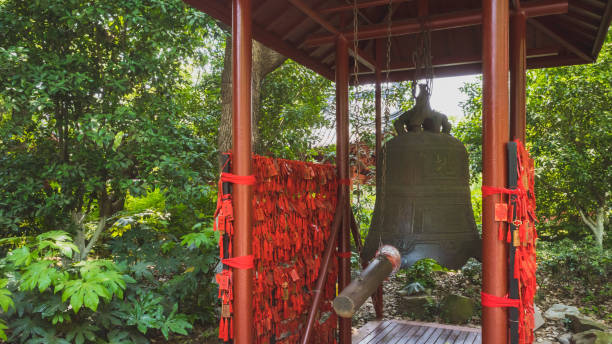 giant bronze bell and red chinese prayer charms, hangzhou, china - gradients golden ribbons imagens e fotografias de stock