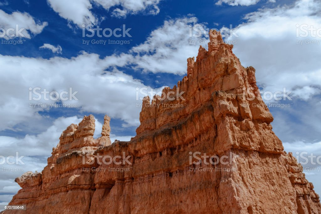 Giant Bryce Canyon Hoodoo against cloudy blue sky. stock photo