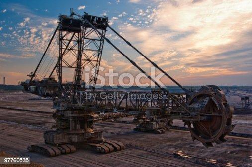istock Giant bucket wheel excavator in an open pit 97760535