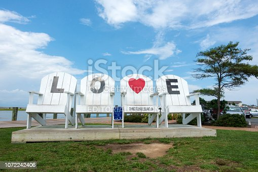 Chincoteague Island, USA - September 1, 2018. Giant chairs with letter LOVE in downtown Chincoteague Island, Virginia, USA