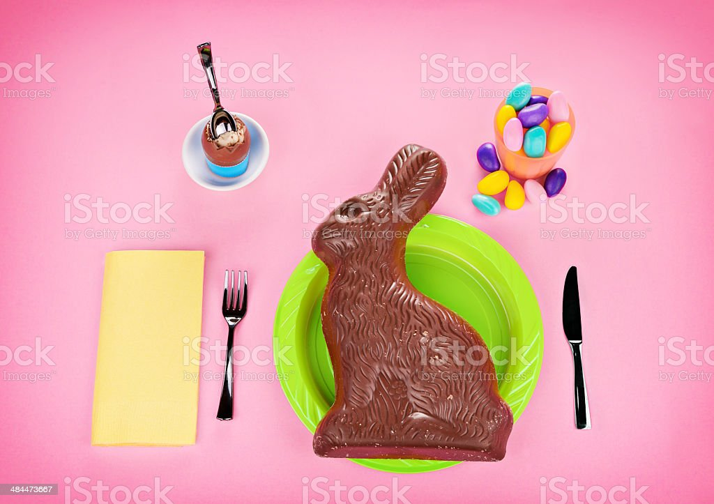 Giant Chocolate Bunny Concept - on Pink stock photo