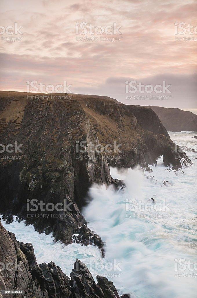 Giant cliffs and pink sunset Maywick Shetland Scotland royalty-free stock photo