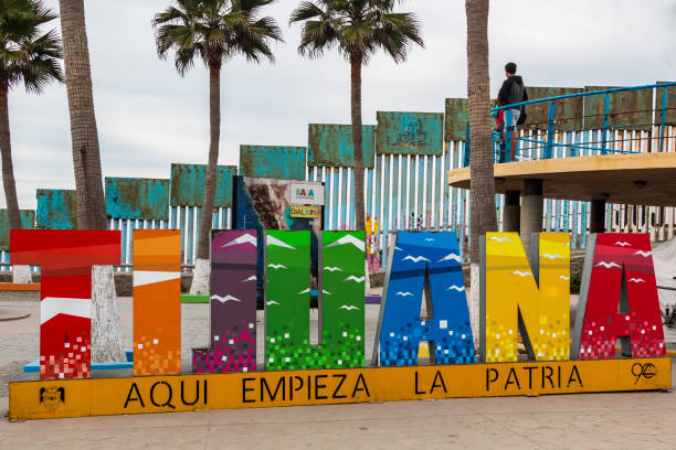 Giant Colorful Sign at Playas de Tijuana Near the International Border Wall stock photo