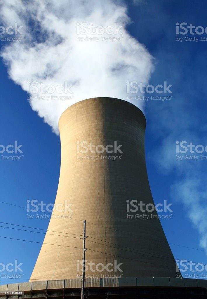 Giant concrete chimney in an energy plant royalty-free stock photo