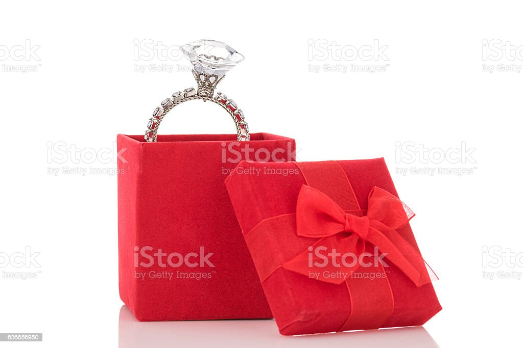 Giant diamond ring in red box isolated on white background – Foto