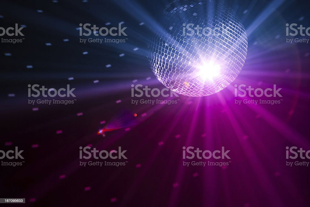 Giant disco ball shining light from above stock photo