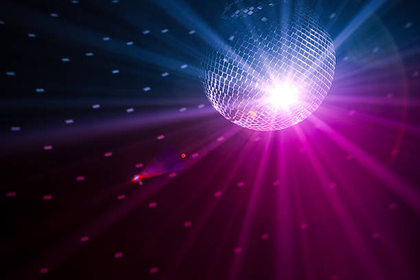 giant disco ball shining light from above - clubbing stock pictures, royalty-free photos & images