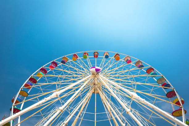 Giant Ferris wheel at the park Giant Ferris wheel at the park ferris wheel stock pictures, royalty-free photos & images