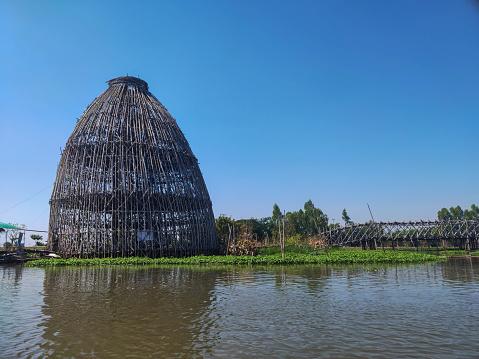 Giant fish trap and bamboo bridge at floating market,Tha Chin River, Thailand