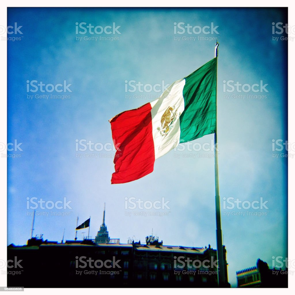 Giant flag of Mexico with blue sky royalty-free stock photo