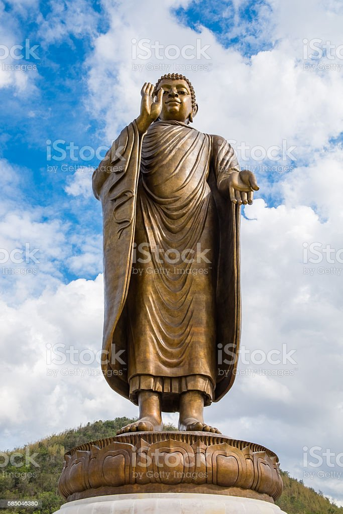 Giant golden buddha standing scenic in buddhist place stock photo