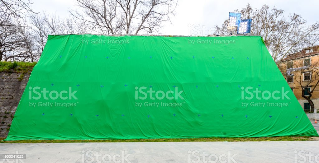 Giant green screen chroma key background on commercial set. stock photo
