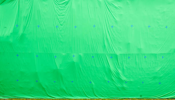 giant green screen chroma key background on commercial set. - green screen background stock photos and pictures