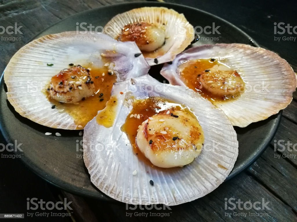 Giant Grilled Fresh Tasmanian Scallops With Fresh Butter On Black ...