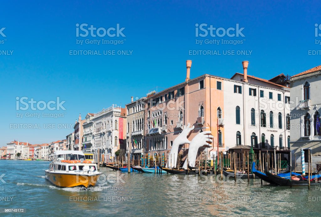 Giant Hands of Venice's Grand Canal stock photo