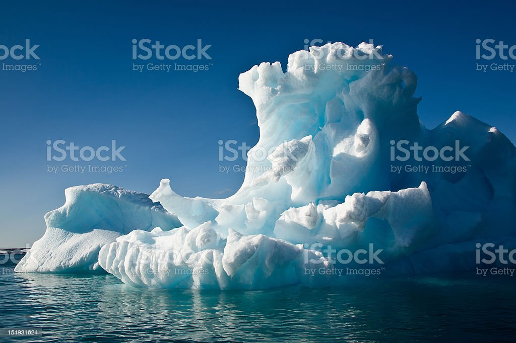 Giant iceberg drifting on the arctic ocean royalty-free stock photo