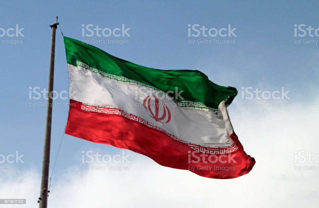 Giant Iranian Flag in the wind stock photo