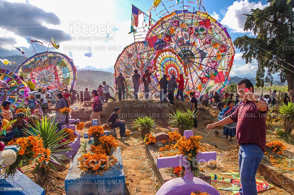 Giant kites in cemetery, All Saints' Day stock photo
