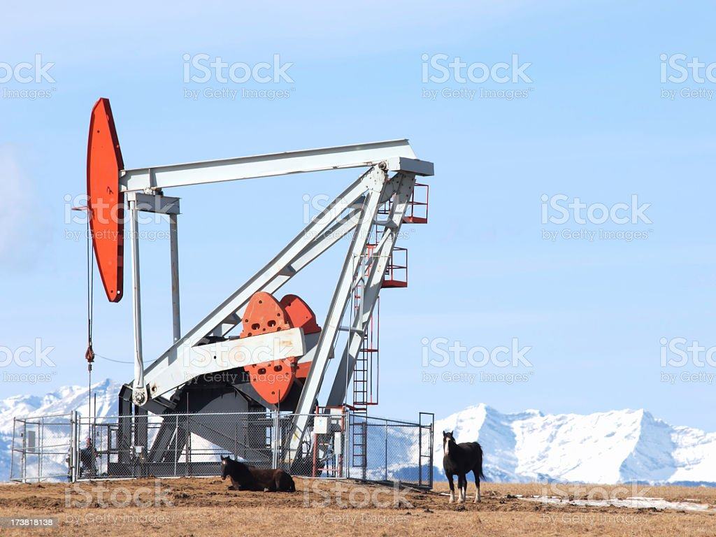 Giant Oil Well Pumpjack & Mountains royalty-free stock photo