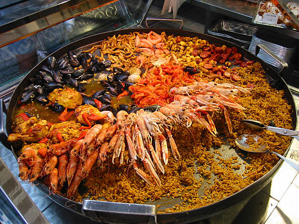 giant paella on a market - fsachs78 stockfoto's en -beelden