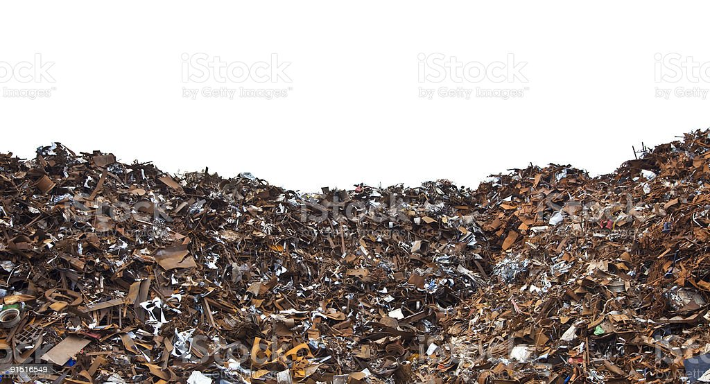 Giant pile of rust and metal scrap at a scrapyard royalty-free stock photo