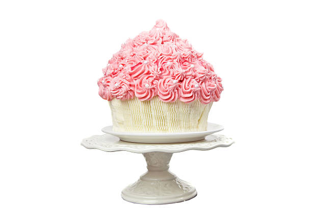 giant pink cup cake - big cake stock photos and pictures