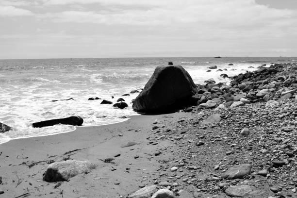 A Giant Rock Near the Sea stock photo