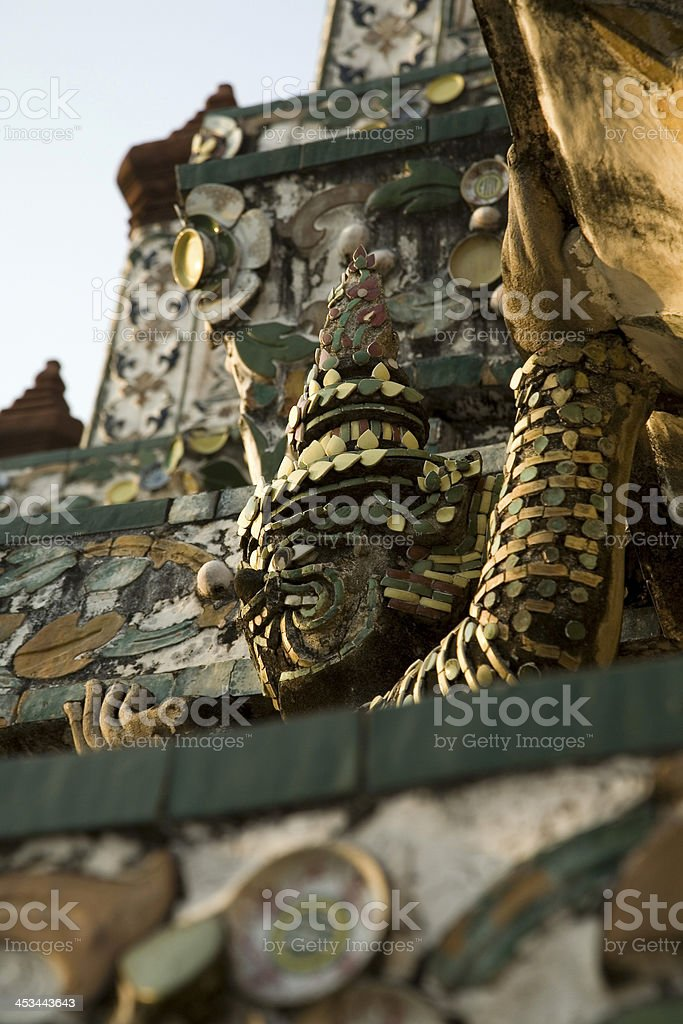 Giant sculpture decorated on pagoda in wat arun royalty-free stock photo