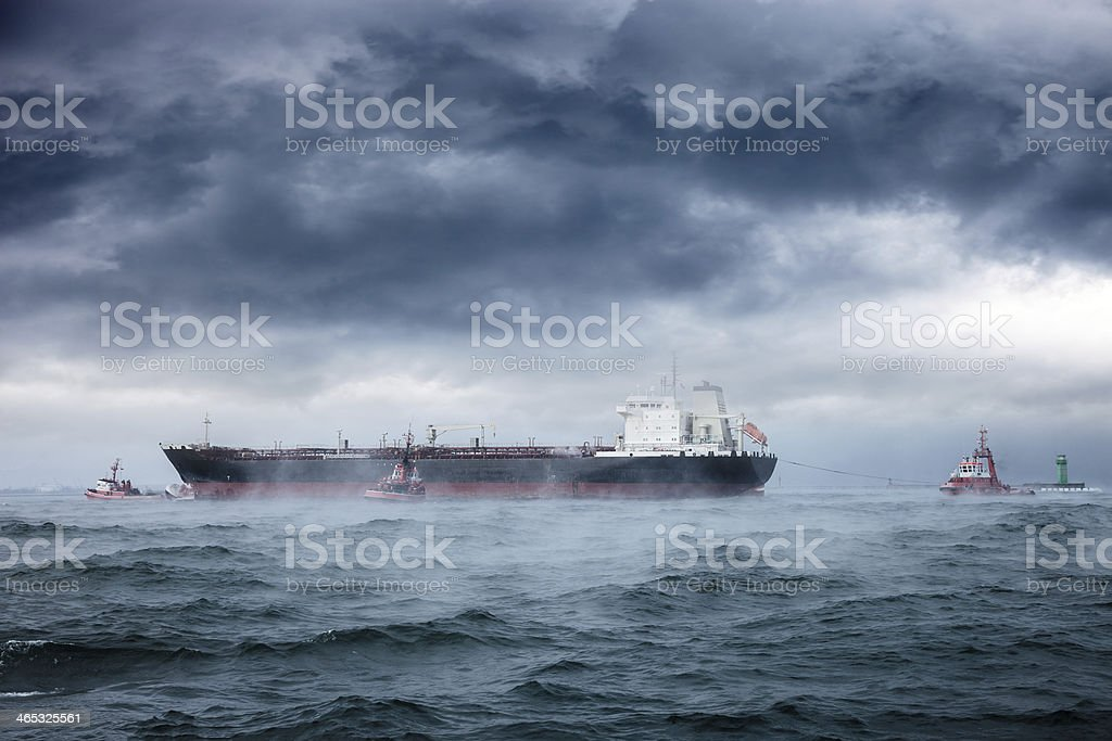 Giant ship at sea during a storm stock photo