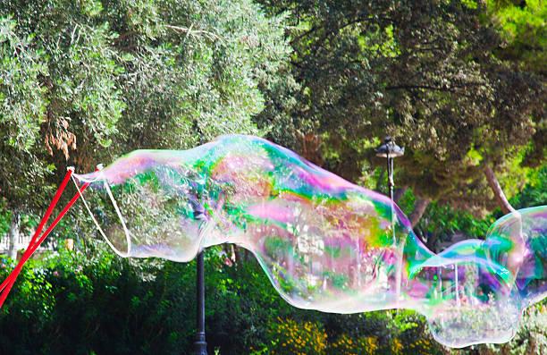 giant soap bubble -, barcelona,, spanien - riesen seifenblasen zauberstäbe stock-fotos und bilder