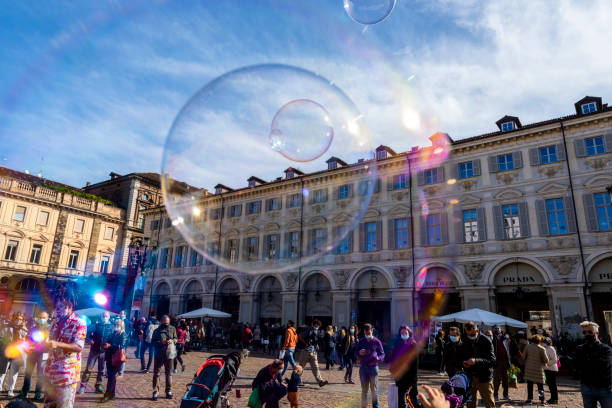 Giant soap bubbles in Piazza San Carlo in Turin (Piedmont, Italy). stock photo