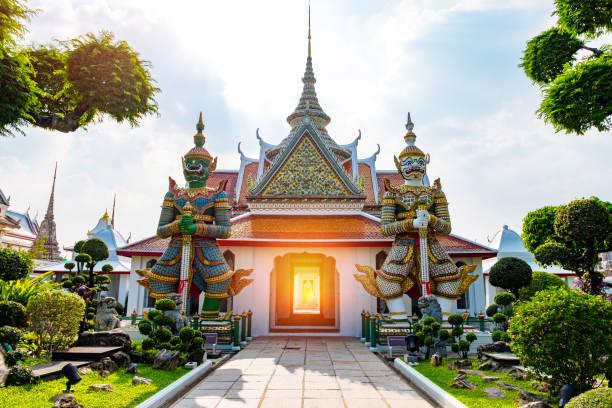 Giant statue at Wat Arun (Sunrise Temple), Bangkok, Thailand. stock photo