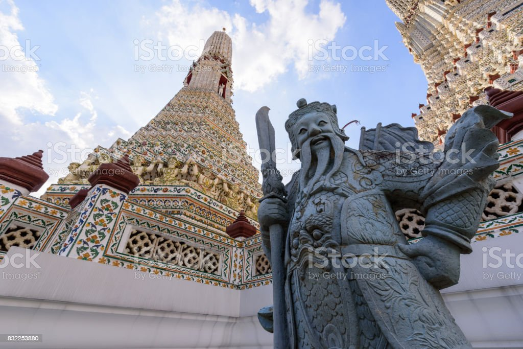 Giant statue in Wat Arun Ratchawararam Ratchawaramahawihan in Thailnd stock photo
