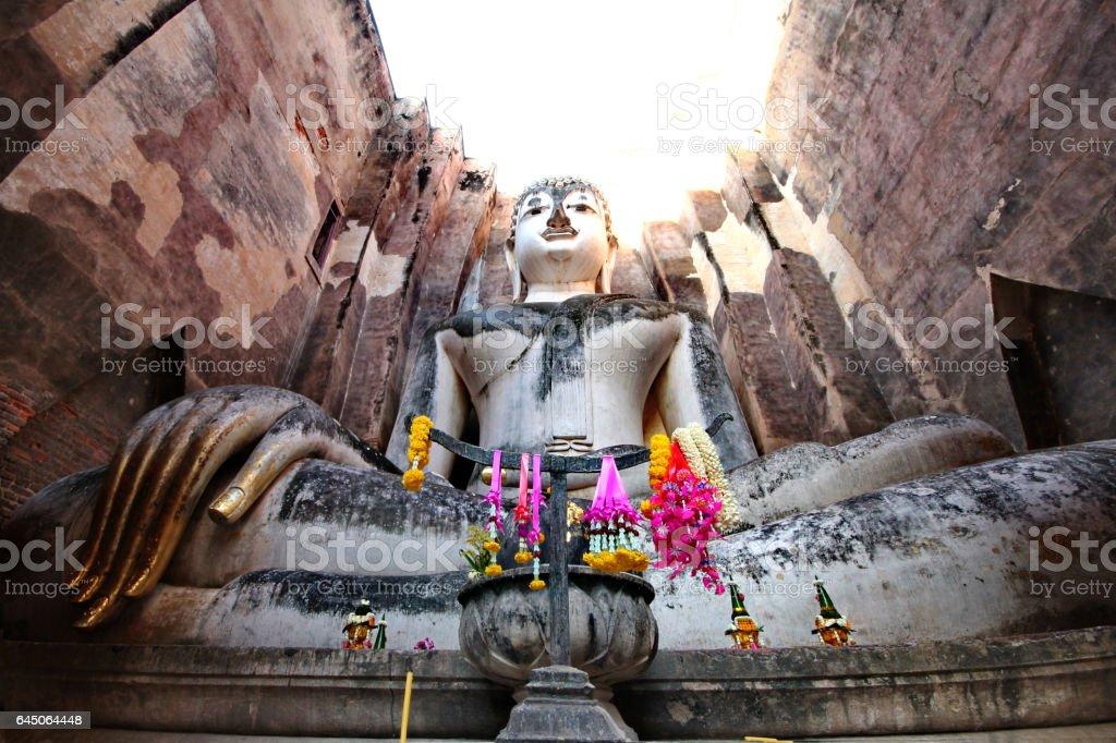 Giant statue of Buddha  in Wat Si Chum , Sukhothai , Thailand. stock photo