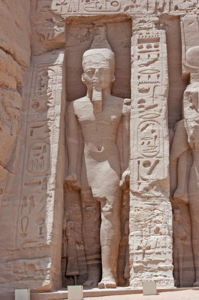Giant statue of Ramses II at Abu Simbel temple stock photo