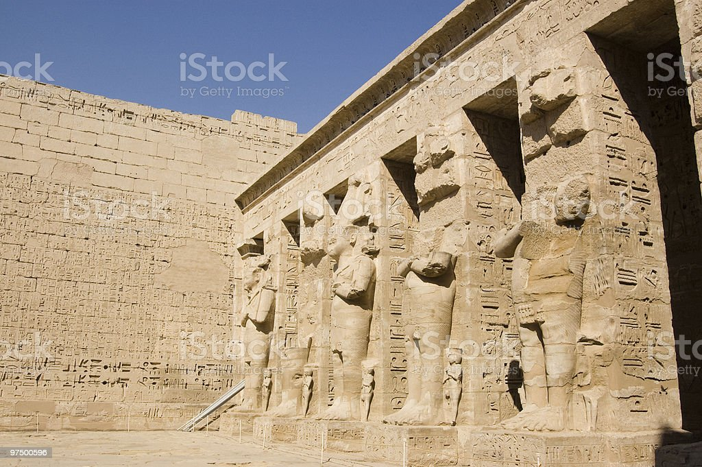 Giant statues, Medinet Habu Temple royalty-free stock photo